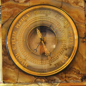 An ornate nineteenth century barometer embeded on the base of the Cornu Clock.