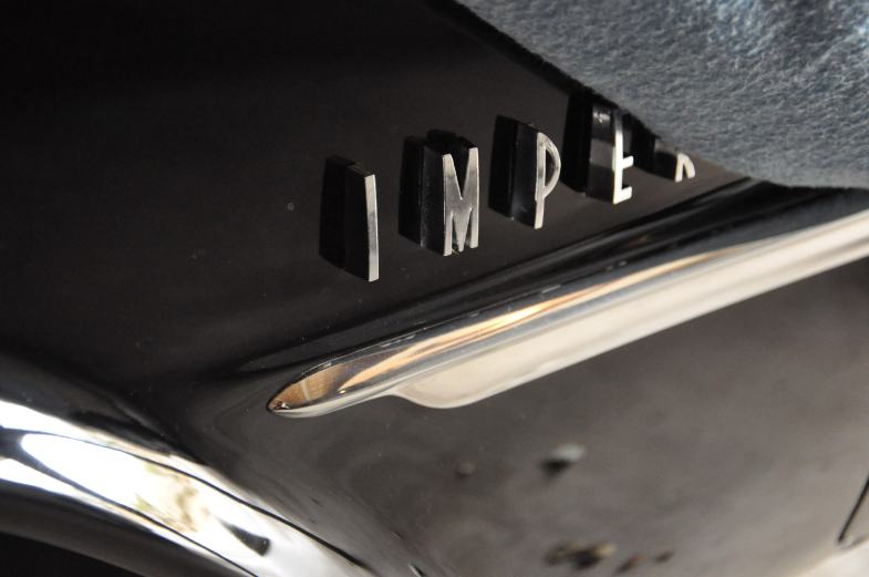 "The letters IMPER on the side of a car. It probably says ""imperial."""