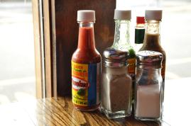 Bottles of hot sauce.