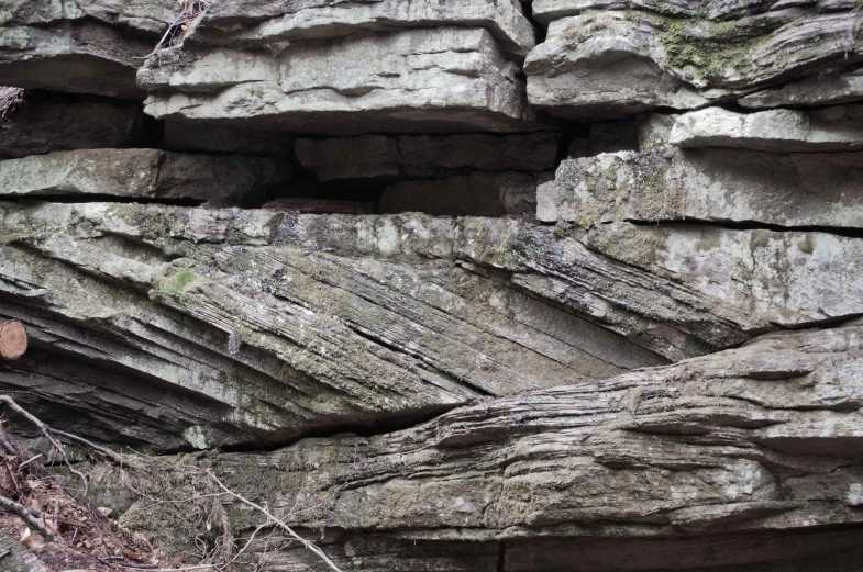 Rocks with diagonal and horizontal fissures.