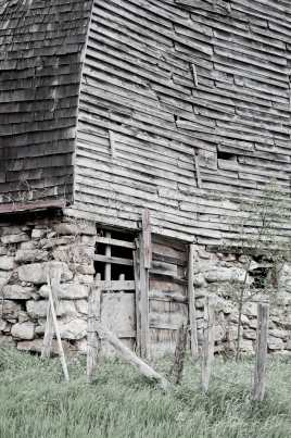 An old barn that is falling down.