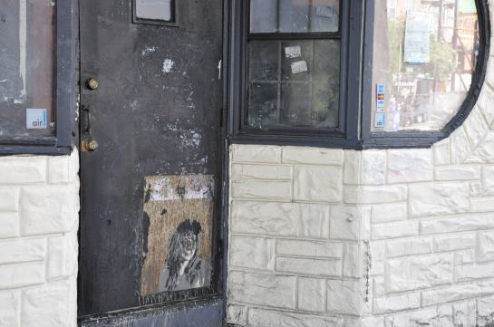 The font door of a storefront that used to be a bar and is no longer occupied.