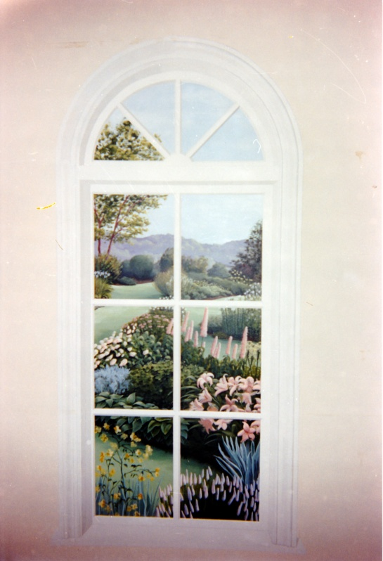 A photograph of a small trompe l'oeil mural of a window with a garden view beyond.