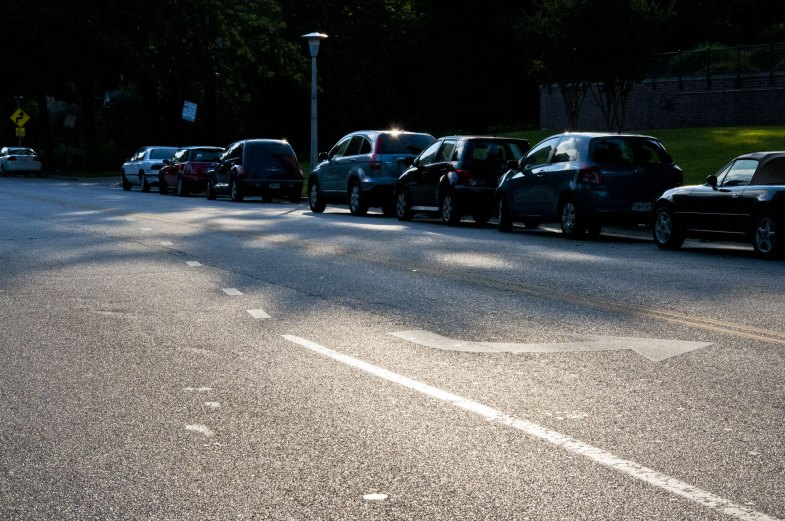 A road with cars parked alongside.