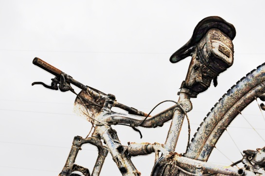 bicycle covered in mud