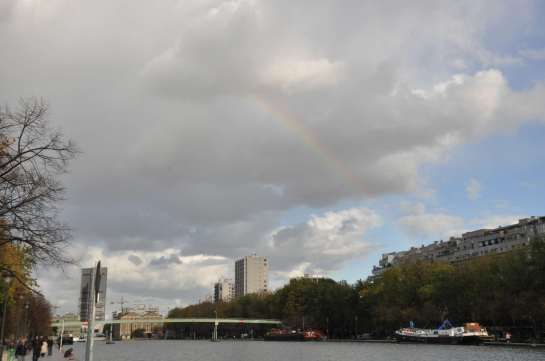 Here, a rainbow can be seen over the canal.