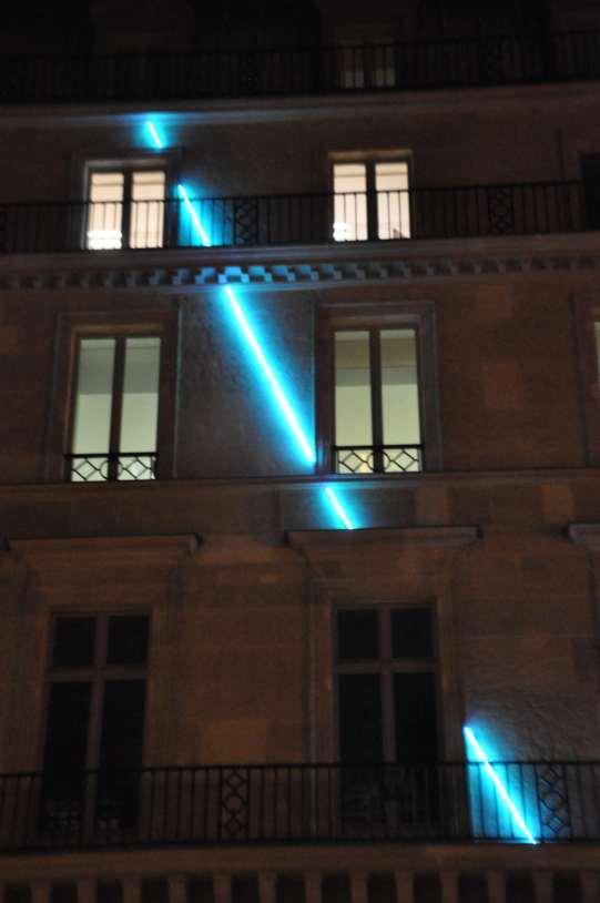 neon art installation on building facade