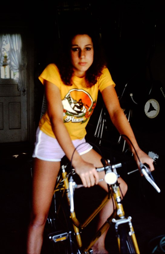 A teenage girl on a bicycle.