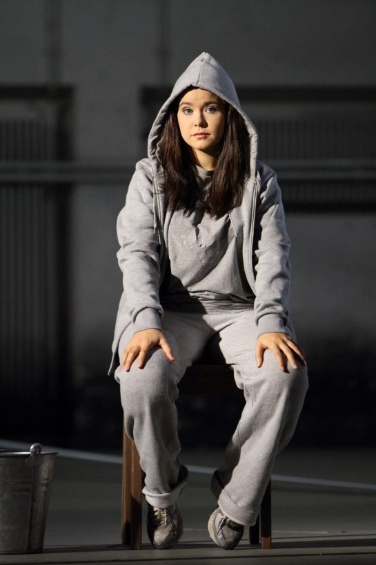 A young woman in a sweatsuit.