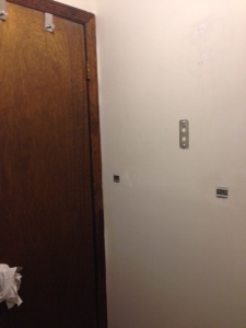 Corner of bathroom showing door.
