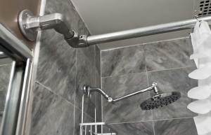 Shower curtain rod and shower head.