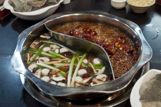 Chongqing was our ultimate destination. Here is the city's most popular food, hotpot. A variety of foods are put into the soup base at the center of the table.