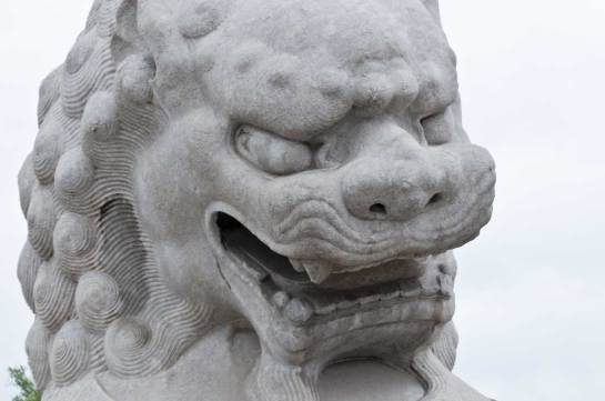 Guardian Lion in front of the Forbidden City.